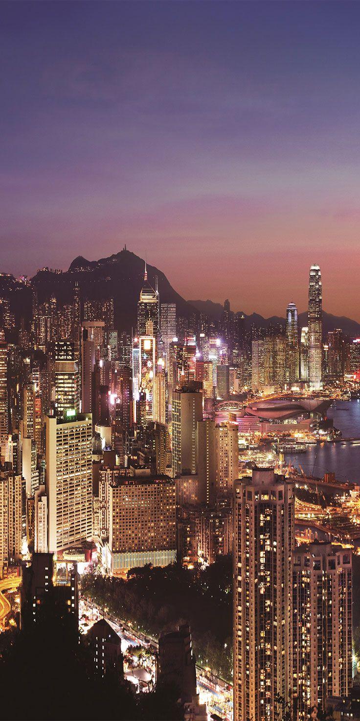 Towering skyscrapers in Hong Kong overlooking Victoria Harbour