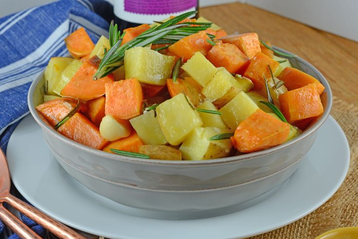 Rosemary Roasted Potatoes is a mix of sweet and Yukon gold potatoes baked to a golden brown with olive oil, fresh rosemary, garlic and sweet onion. An easy side dish for any meal!