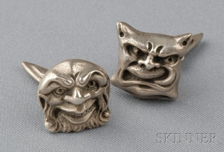 Dragestil .830 Silver Cuff Links, Henrik Moller, Trondheim, Norway, each designed as a grotesque, signed.     Note: Dragestil or, Dragon Style, is a Scandinavian form of Arts & Crafts that draws on Viking and early Medieval motifs. Henrik Moller (1858-1937) was largely influenced by the early architecture found in Trondheim.