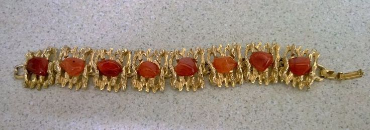 Gold Coloured Metal Bracelet with Amber Coloured Stones