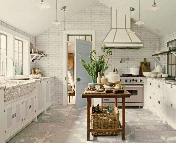 Everything about this is amazing. Subway tile, powder blue door, white and steel hood, marble all over the place.