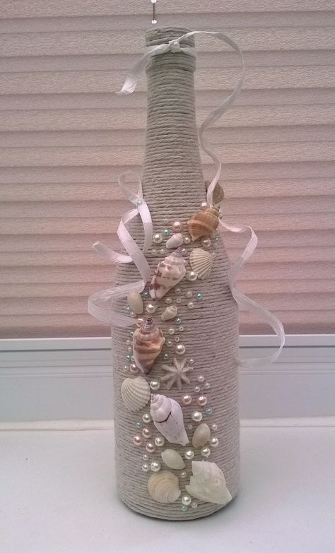How beautiful this would be as a wind chime using shells..j