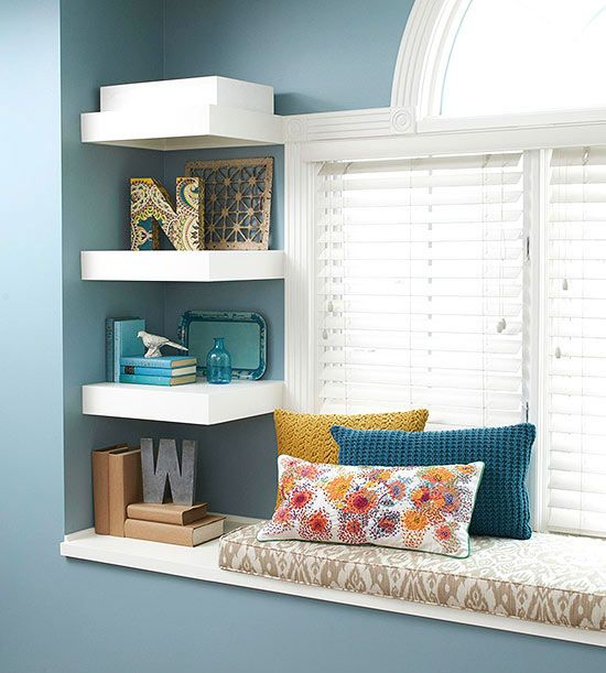 Small stretches of wall space next to windows and doors are all too often ignored when it comes to master bedroom storage. Here, a trio of clever shelves with heft offers space for artful display of treasured mementos.