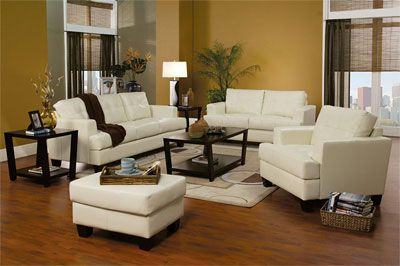 Cream Leather Sofa Set West Family Room! Ok, my friends, I need help, I have a sorta cream, leather sofa/love seat, stainless range/fridge/dishwasher, black counter tops, country white, trim. wooden floors, I need to paint living room/breakfast area and kitchen, also foyer, please help me with ideas on paint colors!! I am doing black accent lamps, and kitchen appliances,  also dark end and coffee tables.. All thoughts and ideals will be considered and appreciated.   TY Hazel..