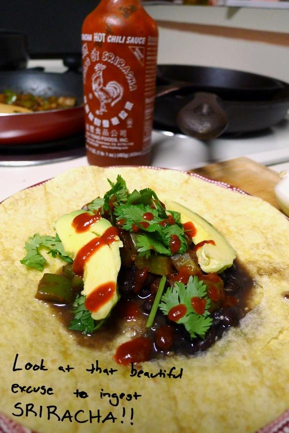 Cheap taco recipe from Jessica Woodrum.  Uses tortillas, taco seasoning, green pepper, onion, black beans, salsa verde/green chiles, cilantro, avocado, and sriracha.