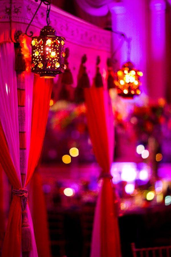 Dim lanterns and bright drapes! -- Indian wedding decor idea by charlene. I could do this- www.atlantaweddingdecor.com