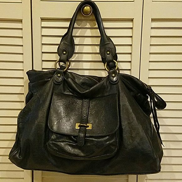 MOVING SALE!!! Sofia C. Handbag Genuine Leather. Large - Perfect school bag or chic weekender. Gold hardware. Used a handful of times, but still in excellent condition! A steal at this price! Sofia C. Bags Totes