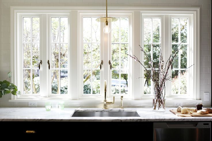 Gorgeous bank of windows in this kitchen!  Timeless Cottage - H2 Design + BuildH2 Design + Build