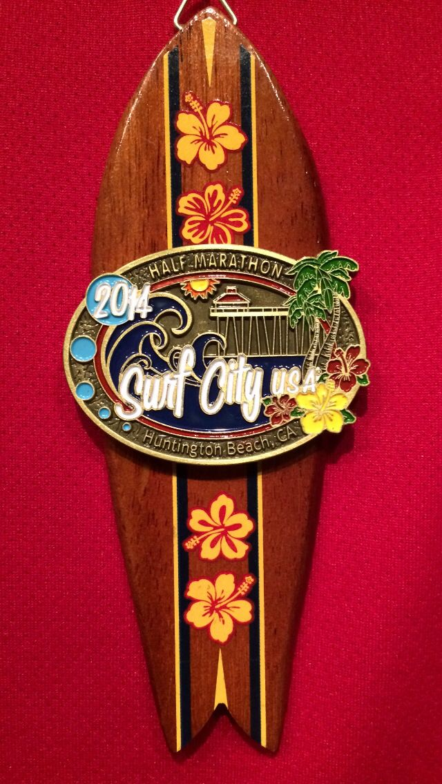 2014 Surf City Half-marathon medal. February 2014.  This medal is very nice.  It's wood and a nice size.  This medal got me hooked in collecting medals!