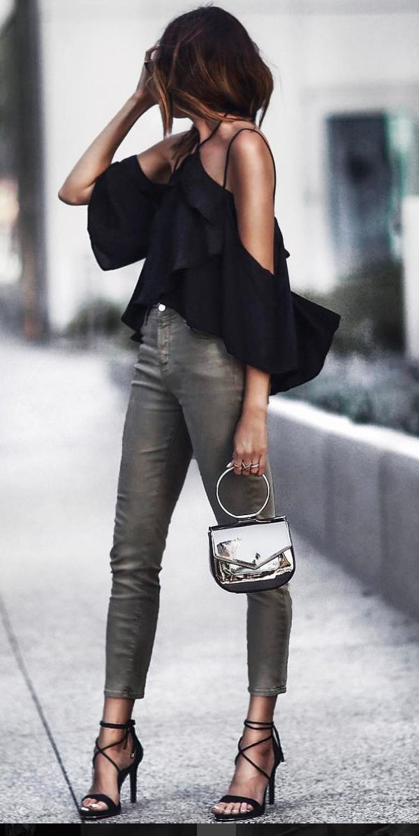 Black cold shoulder top with gray leather jeans.