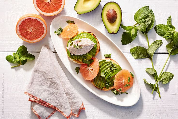 Gourmet breakfast bagel with tuna fish, avocado, grapefruit, and mint  by Trinette Reed