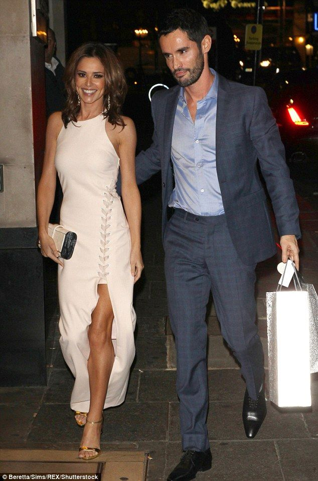 Finally over: Cheryl (left) was handed a decree nisi at the Central Family Court in London...