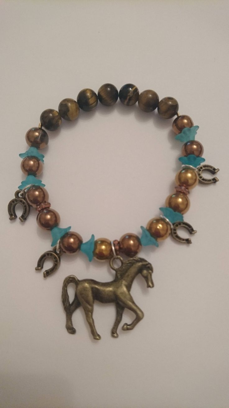 Excited to share the latest addition to my #etsy shop: Bronze and Gold coloured Tigers Eye Gemstone Lucky Horse and Horseshoe charm bracelet, 16cm wrist size http://etsy.me/2hT3bwn #jewellery #bracelet #bronze #animals #gold #no #women #gemstone #horseshoe