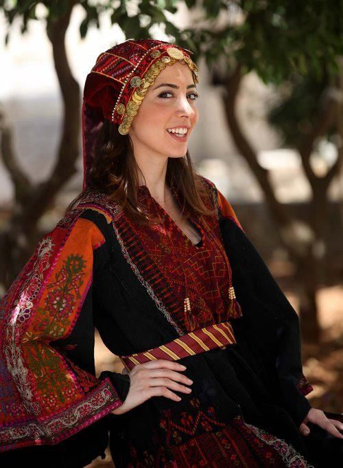 Traditional Palestinian clothing. my mom wore these to weddings in Palestine.