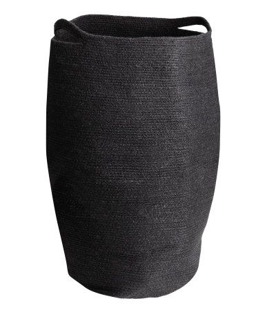 Black. Jute laundry basket with two handles. Diameter approx. 13 3/4 in., height 25 1/2 in.