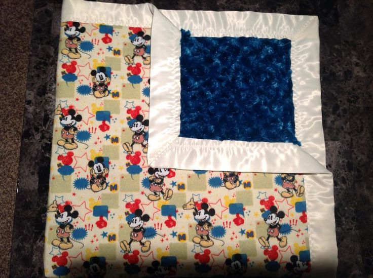Mickey Mouse with dark blue rose and white trim. 36x36""