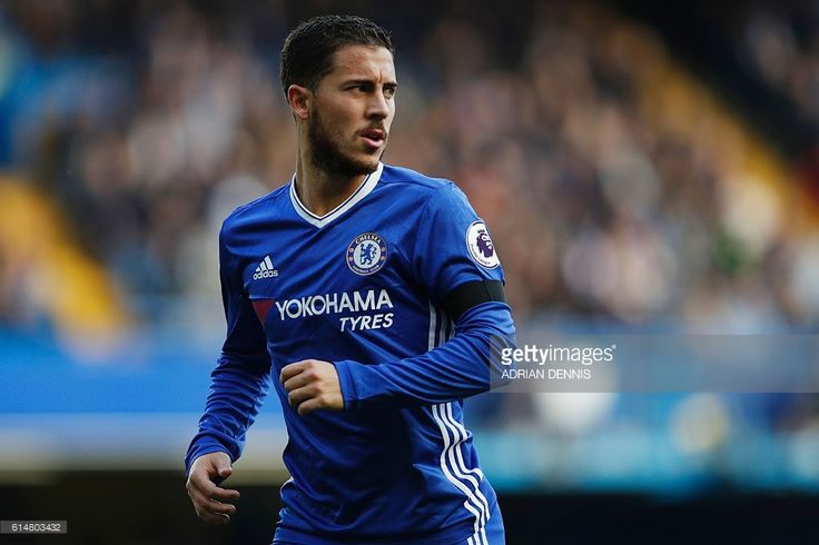 Chelsea's Belgian midfielder Eden Hazard in action during the English Premier League football match between Chelsea and Leicester City at Stamford Bridge in London on October 15, 2016. Chelsea won the game 3-0. / AFP / Adrian DENNIS / RESTRICTED TO EDITORIAL USE. No use with unauthorized audio, video, data, fixture lists, club/league logos or 'live' services. Online in-match use limited to 75 images, no video emulation. No use in betting, games or single club/league/player publications. /