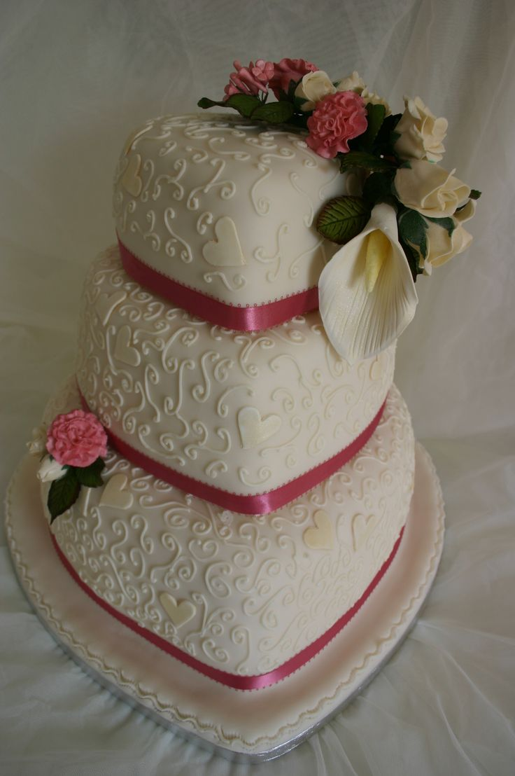 Dusky Pink and Ivory Heart wedding cake. With delicate piping and hand made flowers