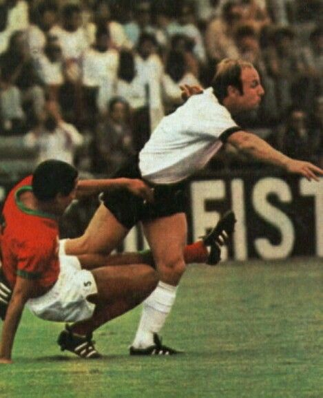 West Germany 2 Morocco 1 in 1970 in Leon. Kacem Slimani challenges Uwe Seeler in Group 4 at the World Cup Finals.
