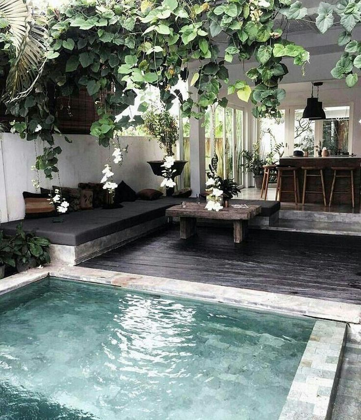 this looks like the most amazing location. crystal clear pool and greenery all around