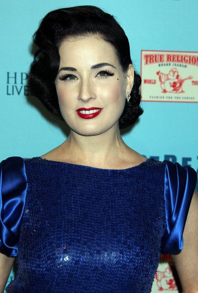 Dita Von Teese Retro Updo - Dita Von Teese always steps out looking elegant. The dancing diva spiced up her look with retro Marcel waves and a swipe of vivid red lipstick.