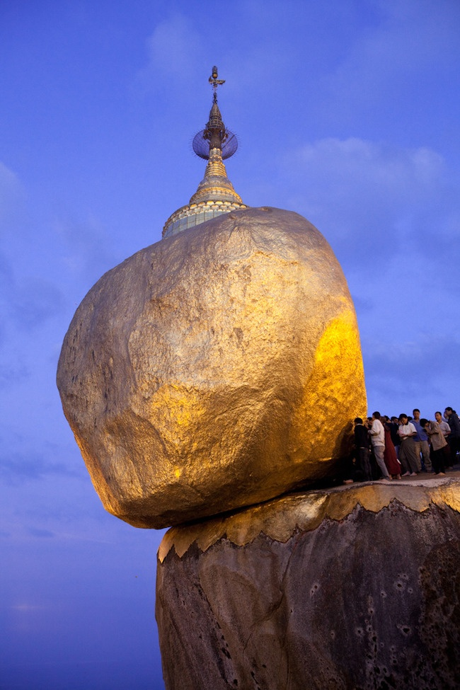 Kyaiktiyo Pagoda, Kyaikhto Mountain, #Myanmar (previously Burma) is a place of Buddhist pilgrimage where gold leaves are pasted on by devotees. They say the rock seems to defy gravity yet keeps its precarious balance because of a single hair from Buddha.