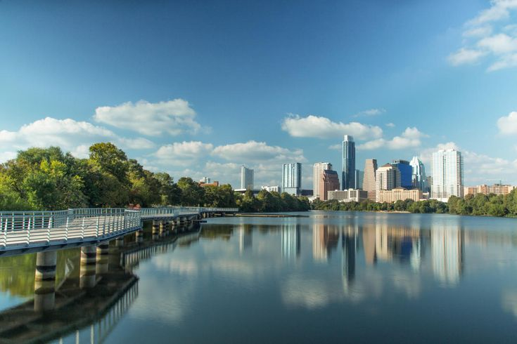 Ten miles of hiking and cycling trails, known as the Ann and Roy Butler Hike and Bike Trail, meander through downtown Austin, encircling Lady Bird Lake. The trail is easily accessible and connects iconic Austin landmarks.