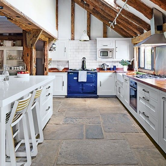 The blue AGA range cooker really is the focus of this modern kitchen design in a converted barn.   http://www.housetohome.co.uk/house-tour/picture/take-a-tour-around-a-pale-grey-country-kitchen