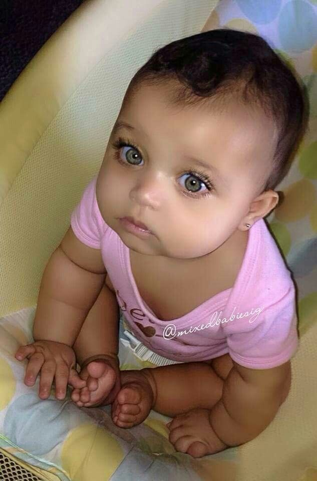 Gorgeous baby girl with amazing green eyes