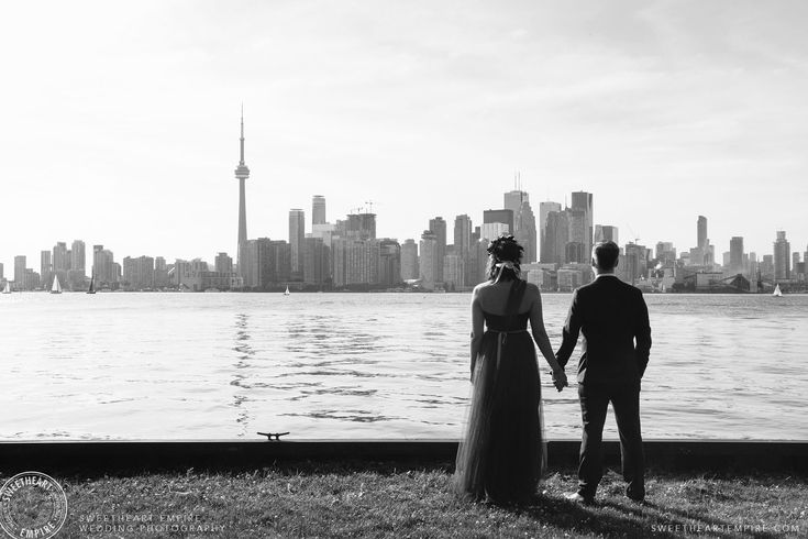 The bride and groom enjoying the view of the Toronto skyline, from Wards Island. Toronto Island Wedding Photographer Review. #sweetheartempirephotography