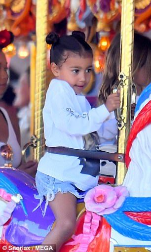 Tied up tresses! North West, three, looked adorable in pigtail buns...