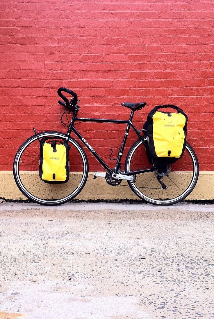 Review of a custom-built touring bike by one of Australia's master frame builders: http://cycletraveller.com.au/australia/gear-review/geoff-scott-clamont-touring-bicycle-disc-brakes