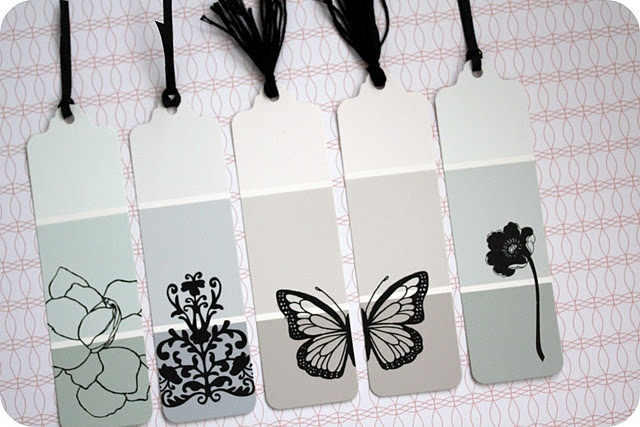 Really cute! I'm always in the need for a bookmark! Paint chip bookmarks. Need: paint chips, corner cutter or die plate, rub-ons, and string or ribbon