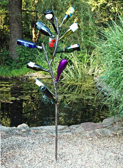 Make a cheerful, festive garden feature with your own choice of different colored wine bottles. Our special design is made from sturdy steel, but it curves and branches like a tree and the surface is