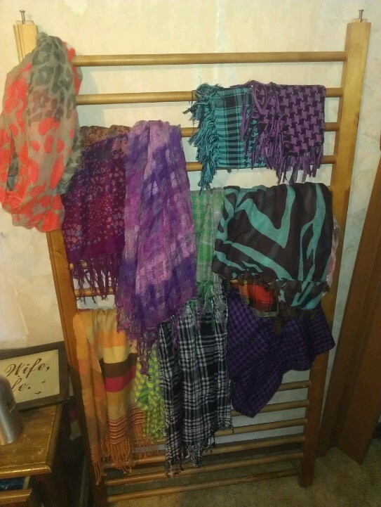 Knotting scarves around a bar attached to the wall is a good way to display them, as is hanging them from a special hanger. Customers often like to try scarves on before buying them, so make sure you have one scarf in each print or color easily accessible. It may also be a .