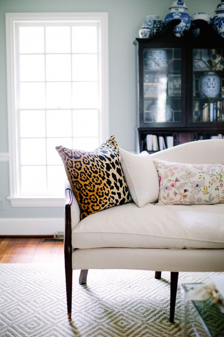 settee, leopard pillow, secretary, blue and white jars