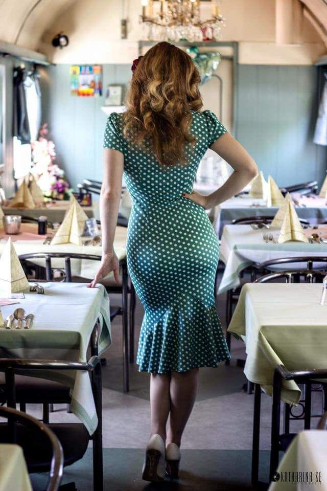 1949s cocktail dress, it's tight fitting to the body which was odd for the era, however this would be perfect for the pinup that comes from America, the style wasn't introduced to this country until the 50s and was used more as models or soft pornography images
