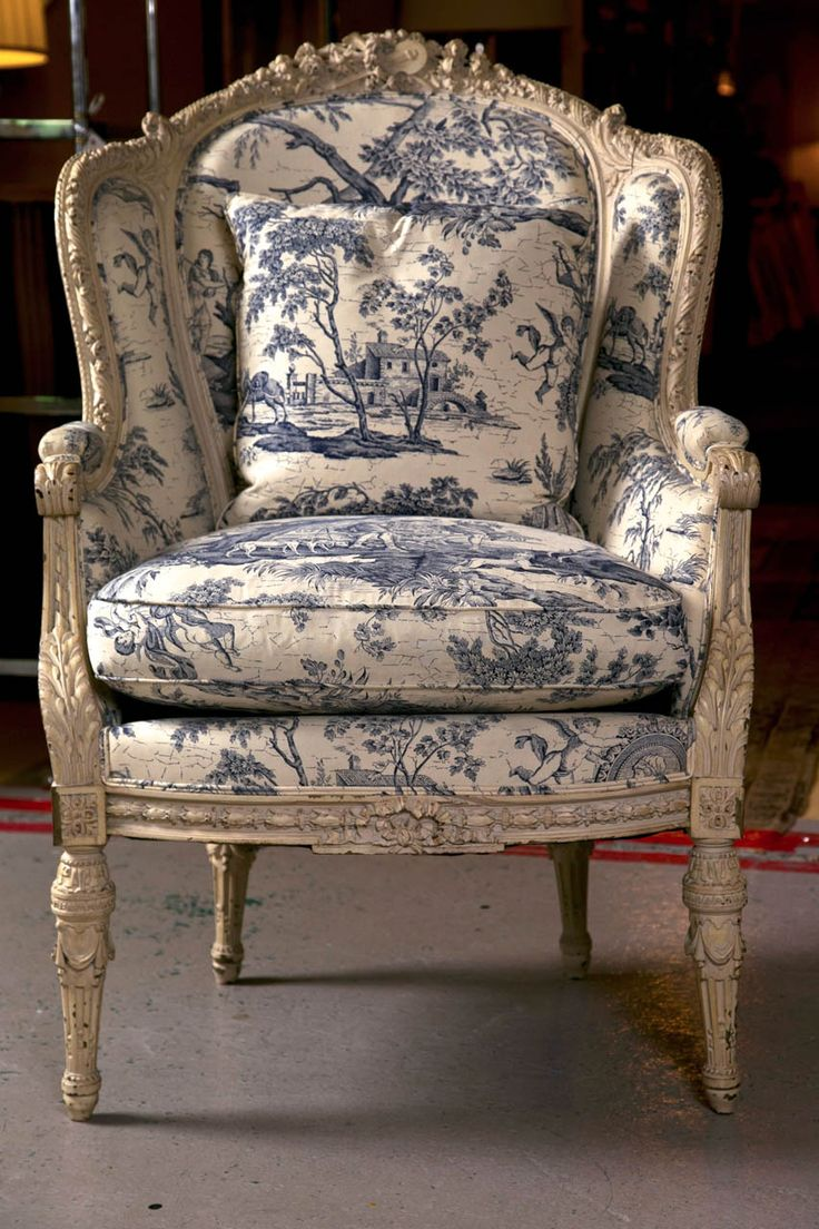 French Wingback Chair... Love the beautiful carvings and blue and white toile jolie fabric. It's just my style!    ~pb~