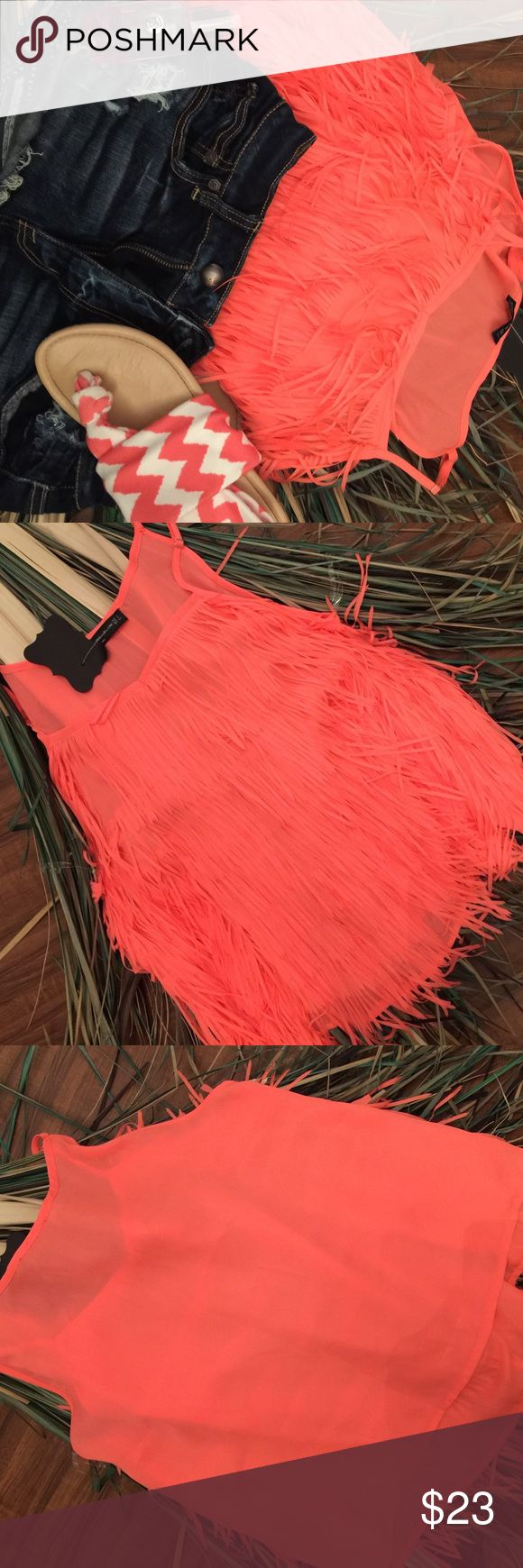 Gorgeous Fringe Top NWT coral colored fringed top that is absolutely adorable💓 says size is small but looks more like Sm/Med Tops