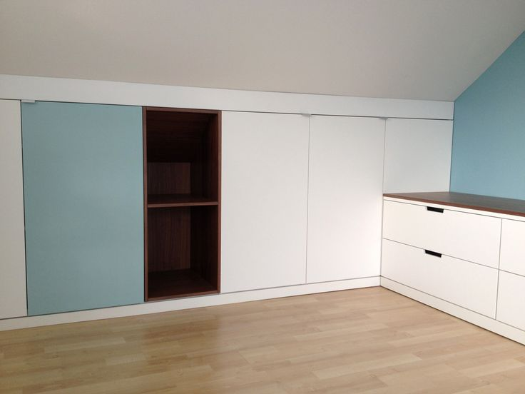 Custom fit cabinets with Walnut accents