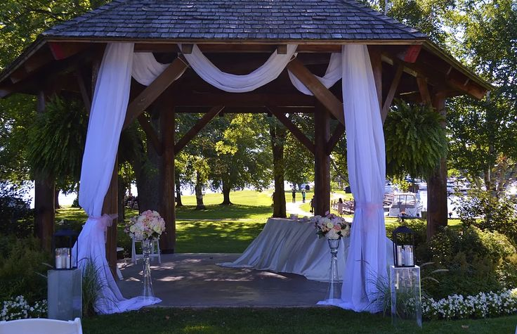 Ceremony decor on the grounds of beautiful Fairmont Chateau Montebello.  Lakeside lovely!  Hydrangeas, roses, lanterns and more made it perfect.