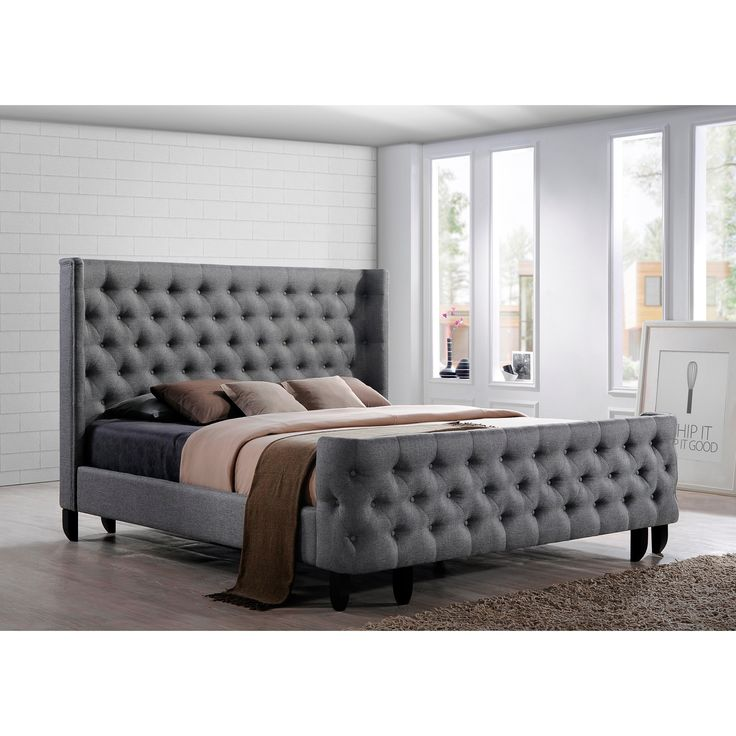 Dream bed a button tufted winged headboard and footboard complete the beauty of the platform Master bedrooms with upholstered beds