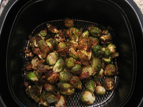 FOR AIRFRYING W/ PHILIPS AIRFRYER:  Set Airfryer to 390 degrees and preheat.  Add prepared sprouts to basket and set timer for 15 minutes.  While cooking, occasionally remove and shake basket or stir.  The sprouts are done when the centers are tender and the outsides are caramelized and a bit crispy.