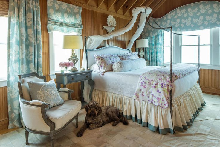 """Give Yourself a Getaway - Best Houses of 2016 - Southernliving. """"As the mother of a fraternity, which is what my house often feels like, this is my little feminine haven,"""" says designer Janie Molster. To create her hideaway, she chose a canopy bed, a ruffled bedskirt, and floral linens, then accented with antiques and a luxurious pieced cowhide rug."""