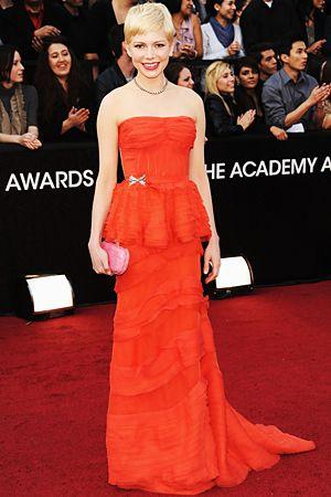 Michelle Williams Oscars 2012  My favorite!  In Louis Vutton  favorite color? Orange/red