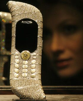 Most expensive cell phone - $ 1.3 million $ Guinness World Records certifies this GoldVish phone as the most expensive in the world--1 million euros, or about $ 1.3 million. The odd-shaped device is made out of 18-carat white gold and features 1,800 diamonds totaling 120 carats. A Russian businessman bought Le Million for his wife last September at a luxury goods fair in Cannes, France.
