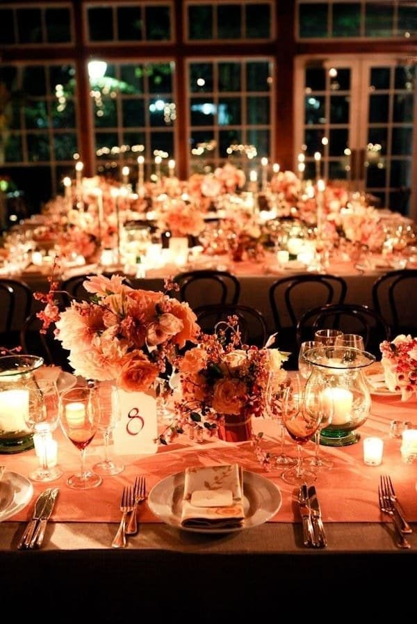 If your reception is at night, these warm orange tablecloths, combined with all these candles, might be just what you need to create an inviting atmosphere.