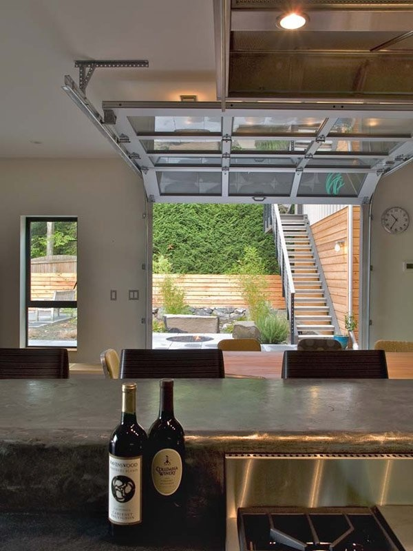 At Ph 1 From Place Houses A Glass Paneled Garage Door Virtually Eliminates The Division
