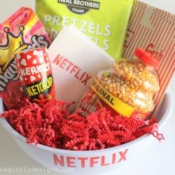 It's super simple to make a fun Netflix gift package!  There are a few key things that you will have to gather:  popcorn, pretzels, candy, popcorn seasoning, a popcorn bowl and a Netflix gift card!  All of the essentials for a fun, family movie night!