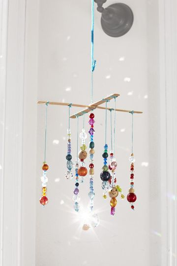 Hang this mobile in a light-filled window to really let it glimmer and glow. Just be sure to keep it out of reach of little kids; the beads are a choking hazard.